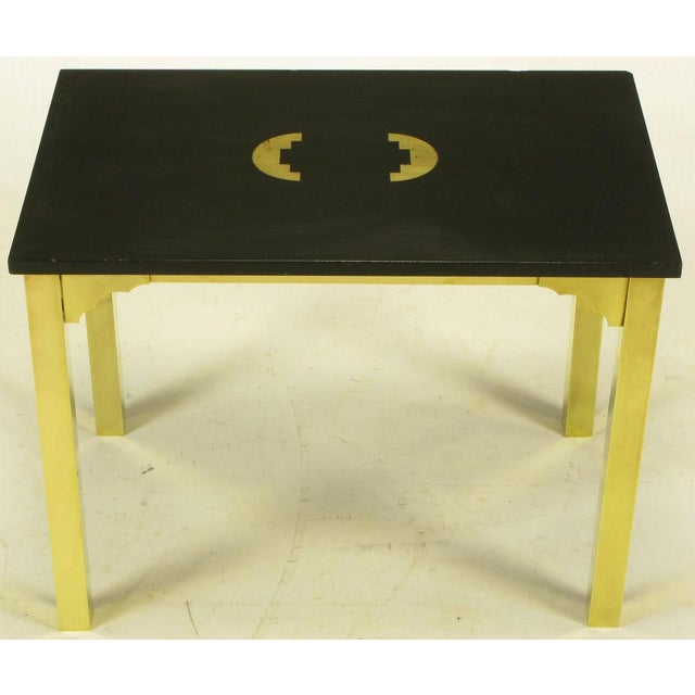 Heavy brass square stock legs with corner brackets and black granite top with inlaid brass geometric pattern.