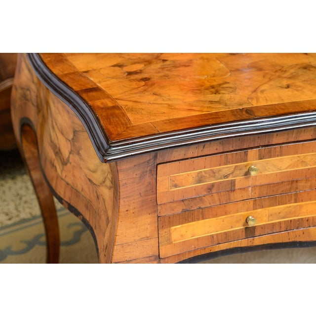 Large scale olive wood writing desk or free standing console / center table trimmed in black. One side has five drawers...