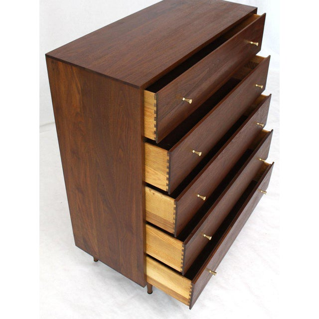 Mid-Century Modern all solid walnut cabinet finished with oil. Beautiful wood grain soiled brass pulls. Attributed to P....