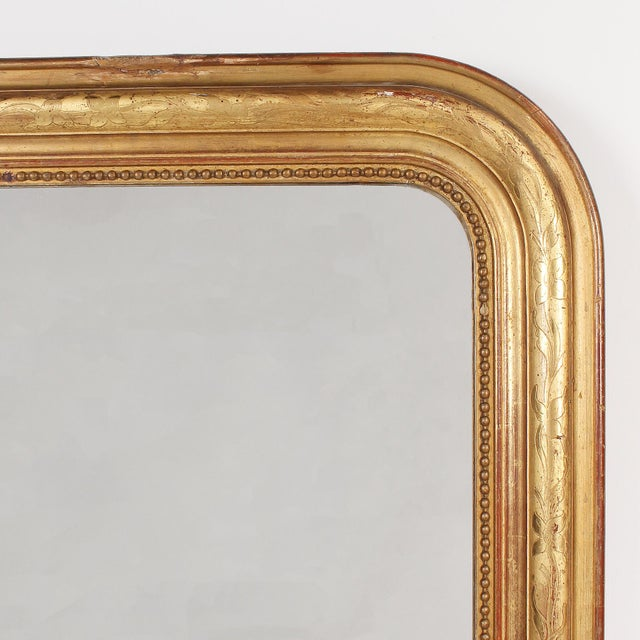 The classic style of this French Louis Philippe giltwood mirror is one that will never get stale. The gold giltwood frame...