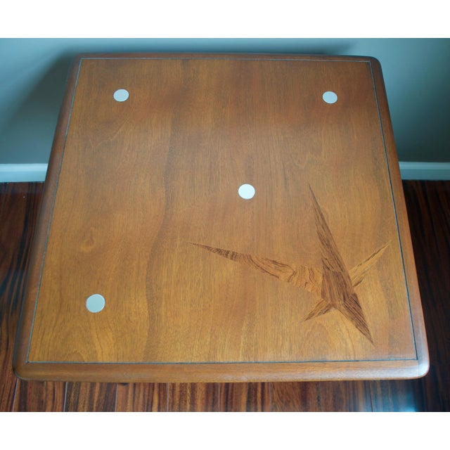 "Well-crafted, rare ""constellation"" side table made by Lane in 1958. This solid wood table has a beautiful wood grain..."