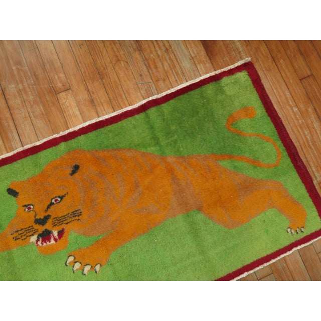 One of a kind, mid 20th-century Hand-woven Turkish Pictorial Rug depicting a very angry tiger . Professionally Washed &...