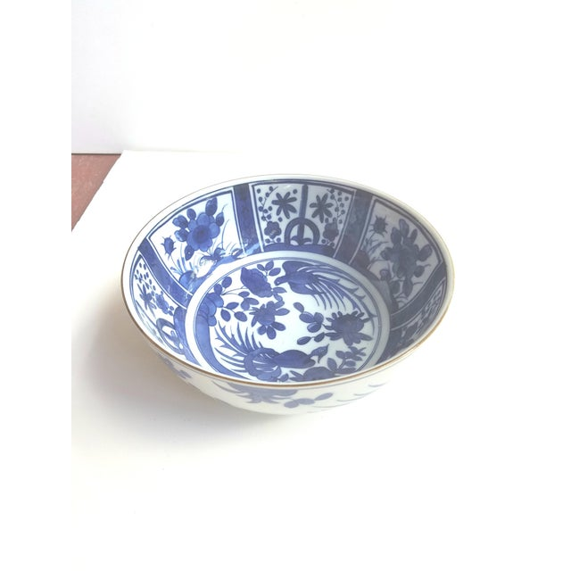 Pretty contemporary Chinese Bowl with birds and floral decoration. Signed on bottom.