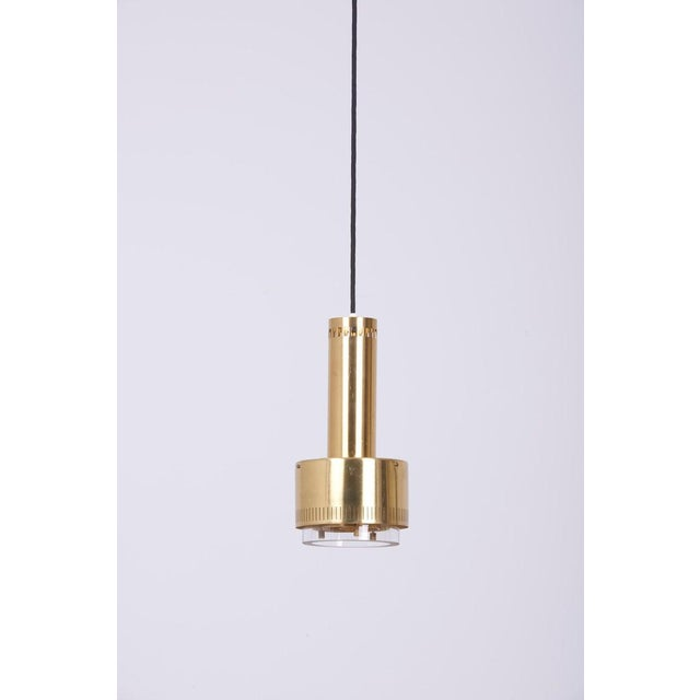 A pair of brass and glass pendants by Kay Korbing for Lyfa, Denmark, 1960 in excellent condition. 1 x E27 / Model A Bulb...