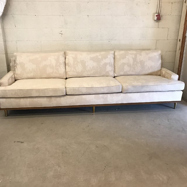 This is a large scale mid-century sofa in great condition with beautiful lines. No makers mark and fairly certain it was...
