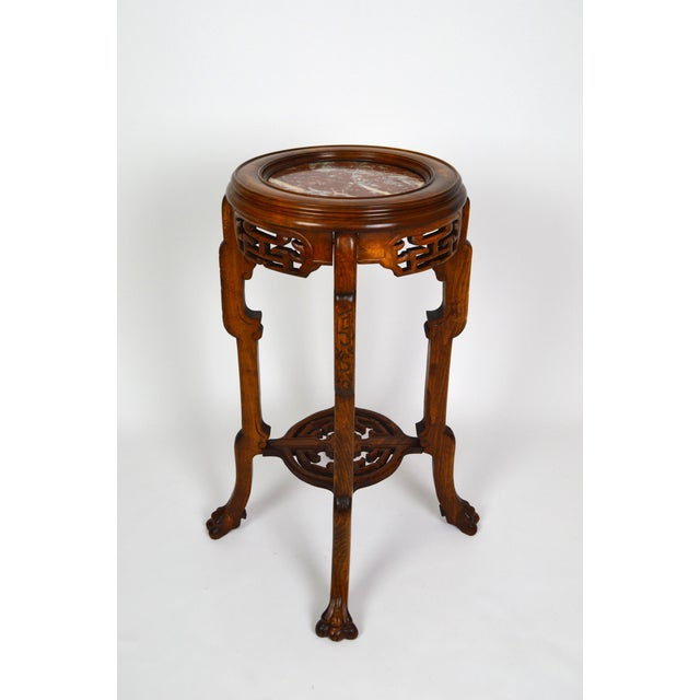Japanisme/Chinoiserie pedestal table or pot stand. Carved beech wood and marble top. Sculpted tiger feet. In the style of...