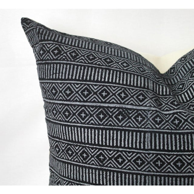 This is a vintage black & white pillow. The piece features a zipper closure, linen back, and an overlocked edge finish....