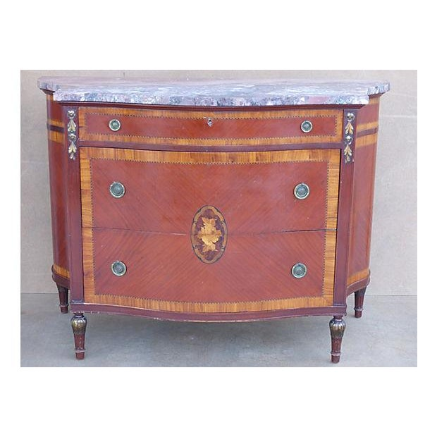 A fine American chest with marquetry and inlay wood work and a richly veined marble top. Created with a lovely bowed front...