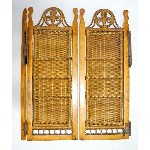 Wooden frame, wicker shutters, original metal hinges. Some rust on hinges, few scratches on wood frame, and parts of the...