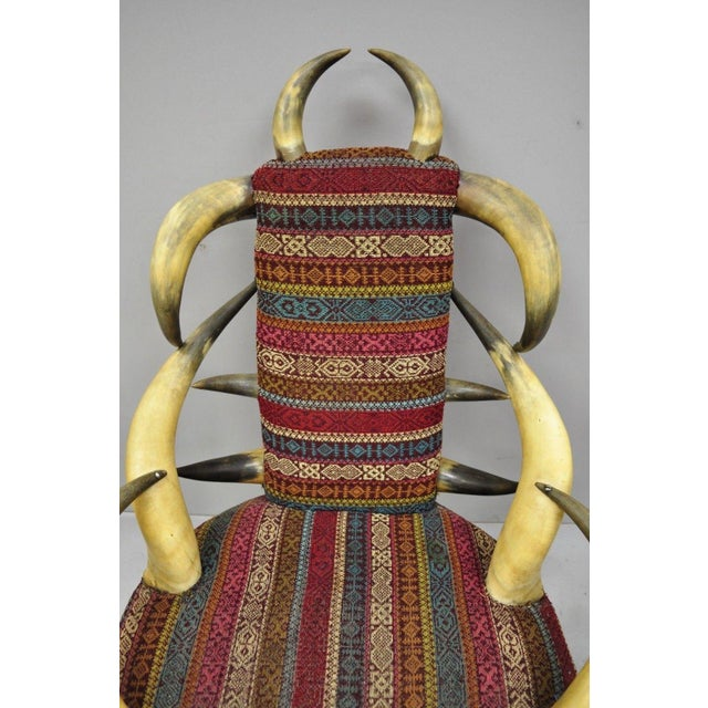 Early 20th Century Steer Horn Parlor Chair. Item features steer horn frame, burgundy & blue upholstery, desirable size and...