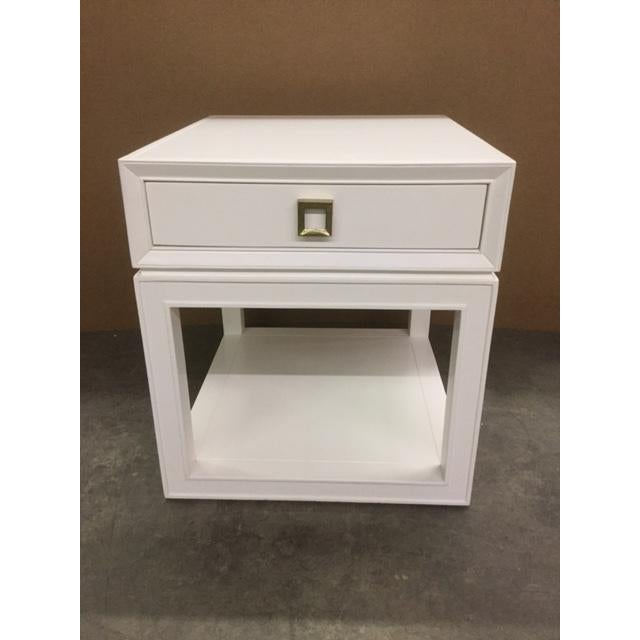 """Malibu Loft"" single drawer end table with an transitional flair. Clean white finish. Antique brass hardware pull."