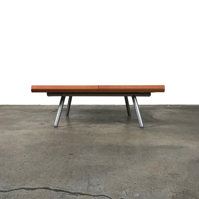 RETAIL VALUE: $3,500 Ligne Roset 'Magic' Extendable Coffee / Dining Table This entirely wooden table transforms by...