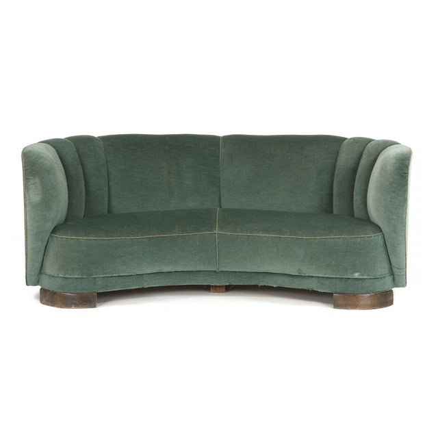 Banana shaped curved sofa in the style of Viggo Boesen and Fritz Hansen, made in Denmark, 1940s. Some wear to green velvet...