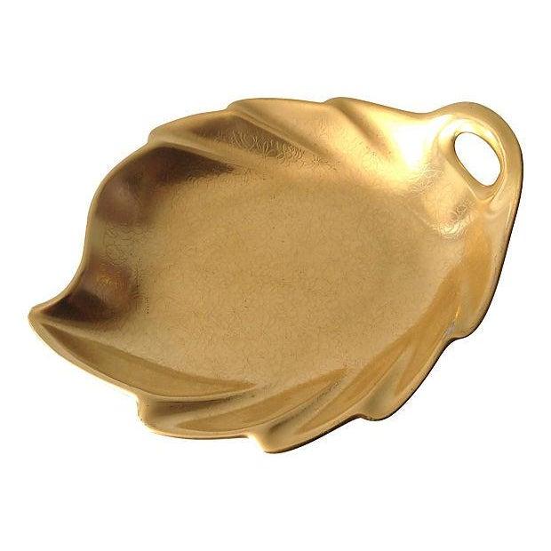 Pickard porcelain leaf-shaped handled dish with burnished 22k gold, and embossed floral motif design. Makers mark verso,...