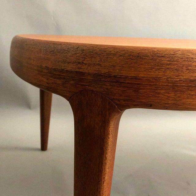 Teak free form midcentury coffee table with de-mountable legs.