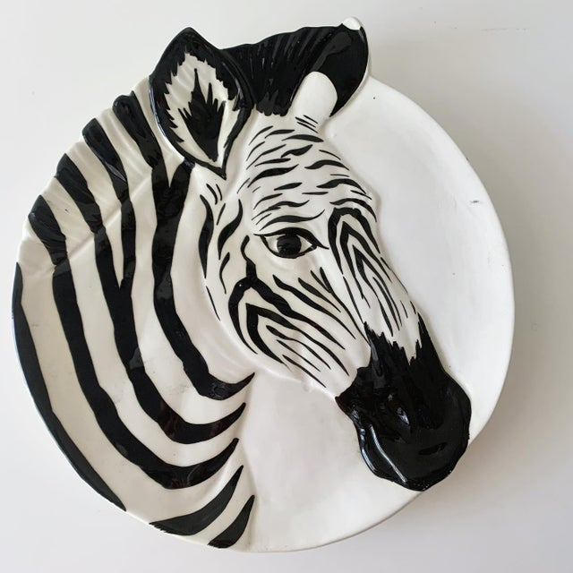 Set of 6, rare, glazed ceramic plates with a relief zebra design. Signed and numbered. Made in Italy for Bonwit Teller....