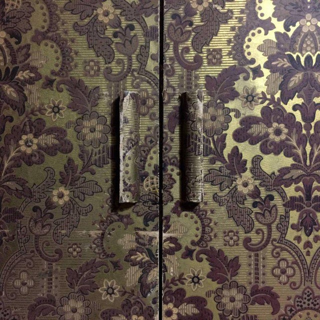 "A pair of moody and decorative door panels circa 1900 or earlier constructed in wood that are each 58"" x 16"" with a lower..."
