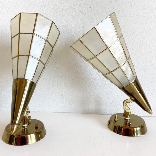 Stunning and rare pair of mid-century wall or ceiling lights by Feldman Lighting with sleek brass-capped capiz shell cones...