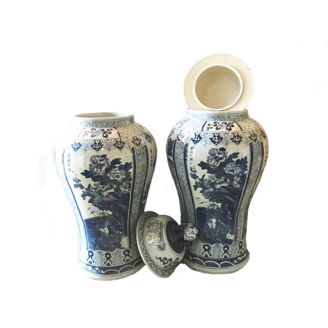 Superb pair of hand painted lidded Porcelain blue and white Chinoiserie mansion size ginger jars depicting the four...