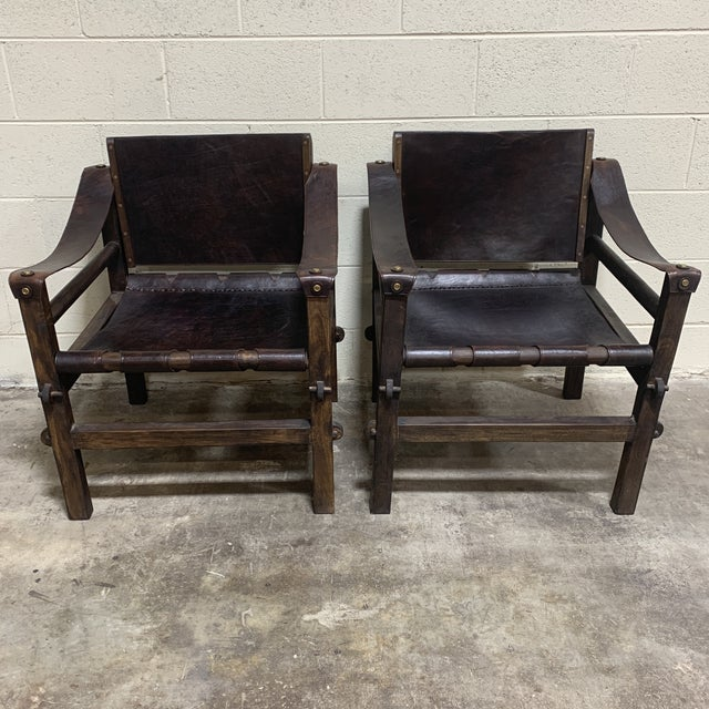 Fantastic pair of leather safari chairs purchased by and from original owners when they lived in Uganda. These are less...