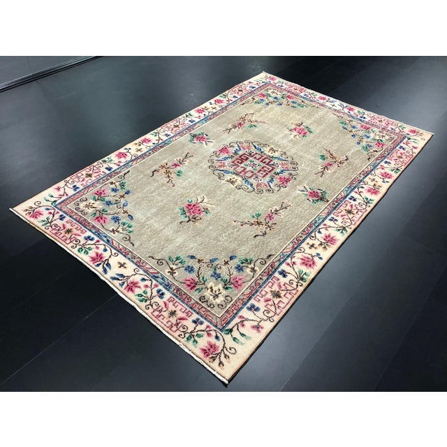 This is a vintage Turkish nomadic wool rug with a perfect design and colors. The piece was handmade in the 1970s.