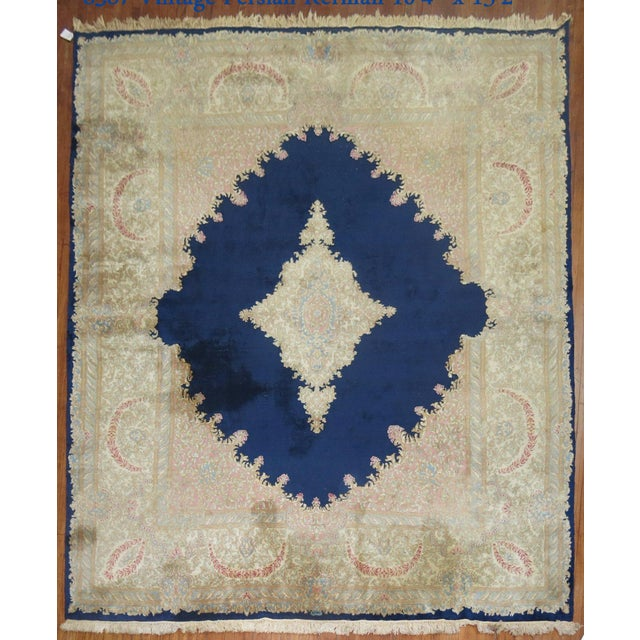 An early 20th century Kerman Rug with classic royal medallion and border motif. circa 1930.