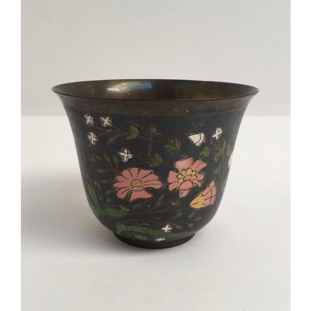 A nice matte black vase or bowl in the asian cloissone style with wire shaping the floral details. Accent colors of green,...