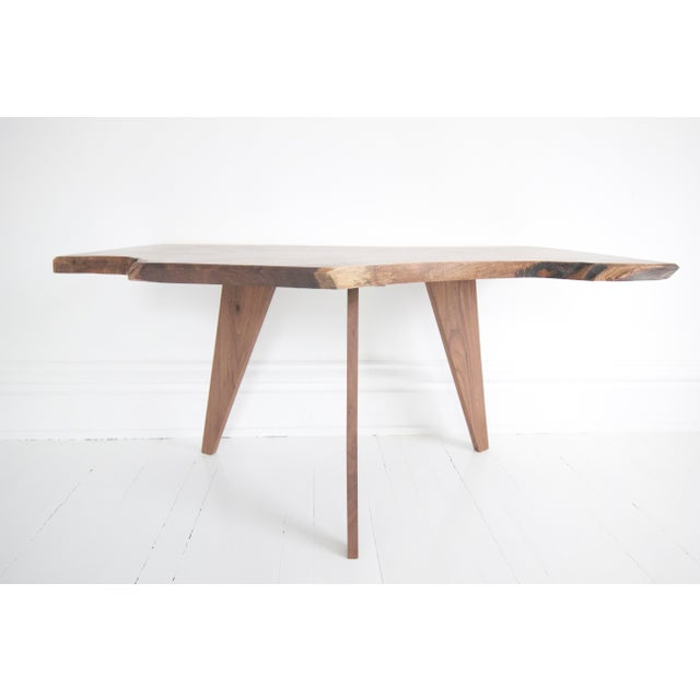 "Solid walnut coffee table with unique angular base - perfect to liven up a smaller footprint Dimensions: Length - 36""..."