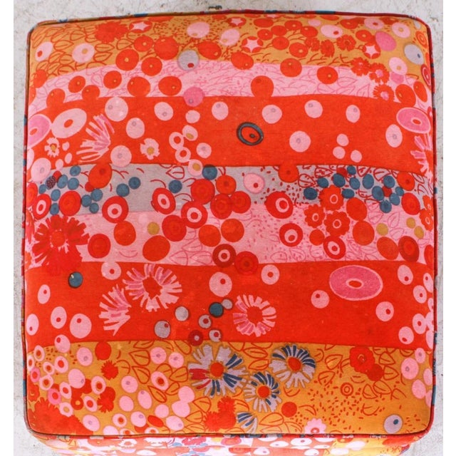 """A large upholstered wheeled ottoman covered in Jack Lenor Larsen's """"Primavera"""" pattern. The ottoman features matched seams..."""