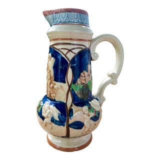 Tall Ceramic Majolica Glazed Cherub Pitcher For Sale