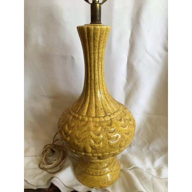 French mid-century modern ceramic lamp in Provence yellow. This pottery lamp is 17 inches tall and with the addition of a...