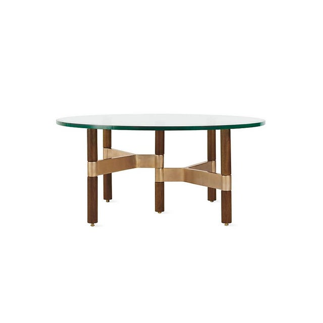 Round helix coffee table from Design Within Reach. I bought brand new in 2014. Beautiful modern design. The metal develops...