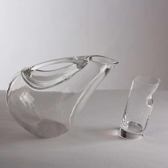 """Rare """"Kyatos"""" pitcher and 12 """"Ice Stopper"""" glasses by Angelo Mangiarotti for Colle. On the pitcher: """"The handle is an..."""