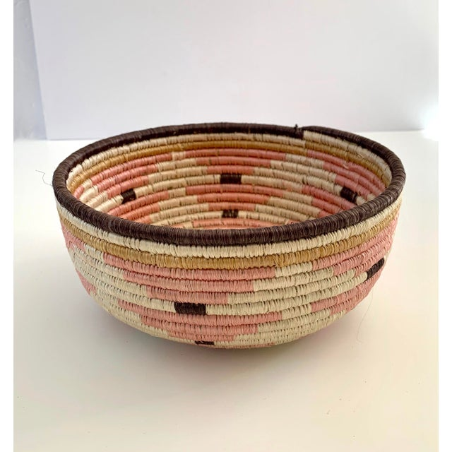 Pale blush, beautiful catch all bowl. Perfect for keeping your household items in, or as a decorative piece. Handwoven in...