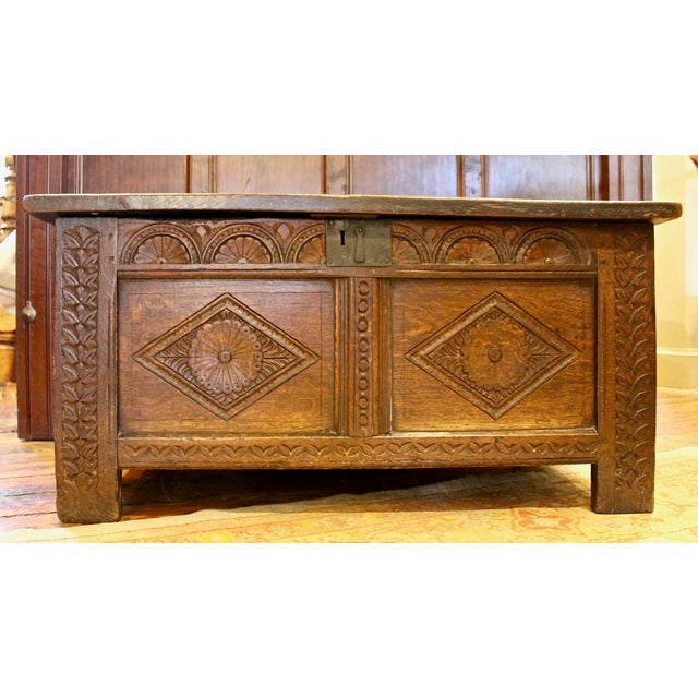 English Oak Coffer, Circa 1700. Joined 2 panel chest with carved semi-lune fan decoration. Old replacement hinges,...