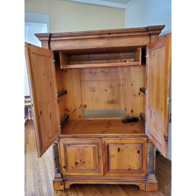 """This light knotted wood entertainment center is made by Henredon. Did you know that the name """"Henredon"""" is a named created..."""