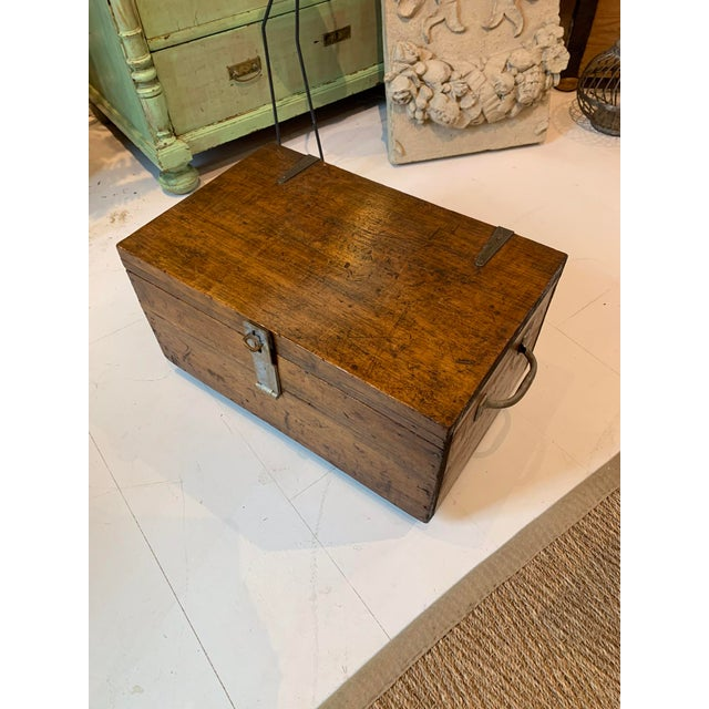 Vintage architect/contractor trunk on wheels. Interior provides dividers for maps or plans. Perfect piece between two club...