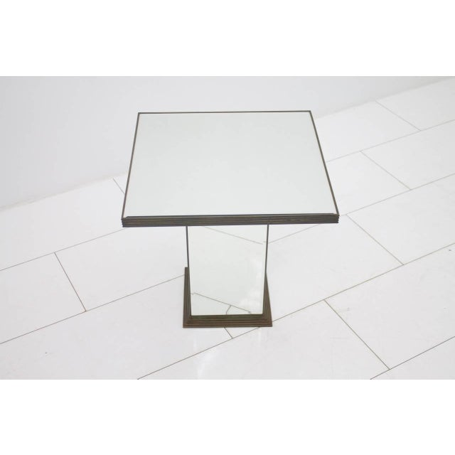 Nice small fully mirrored side or end table with brass details. Excellent condition. Worldwide shipping
