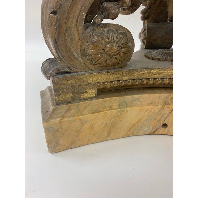 A stunning pair of Jansen tabels featuring eglomise mirror-top, carved burnished pedestal, marble base. Both having Jansen...
