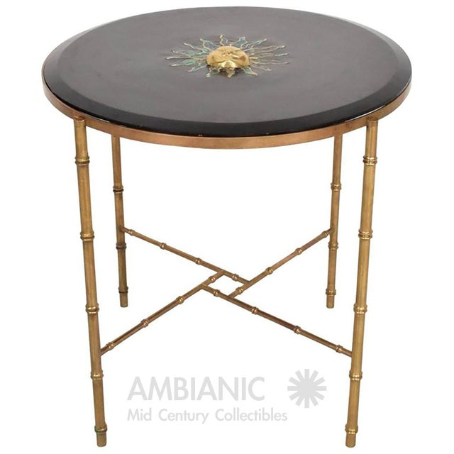 For your consideration a vintage center table. Round shape with faux bamboo in solid brass. Top is wood with beveled edges...