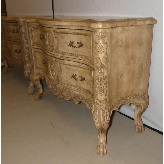 A pair of Ferguson Copeland French Country bedside chests. Gracefully shaped with finely carved details. 2 generously...