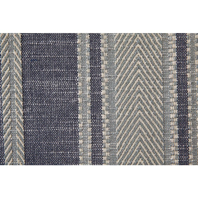 A fine warp crossed with a chunky weft creates a cotton stripe that is rich in denim-like texture and rife with...