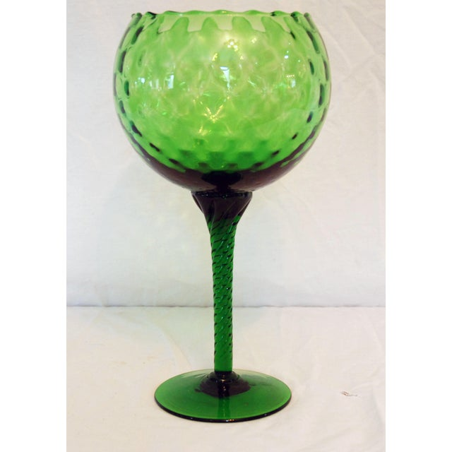 Blown Glass stemmed bowl with twisted stem. This vintage piece is a stunning emerald green hue in excellent condition.