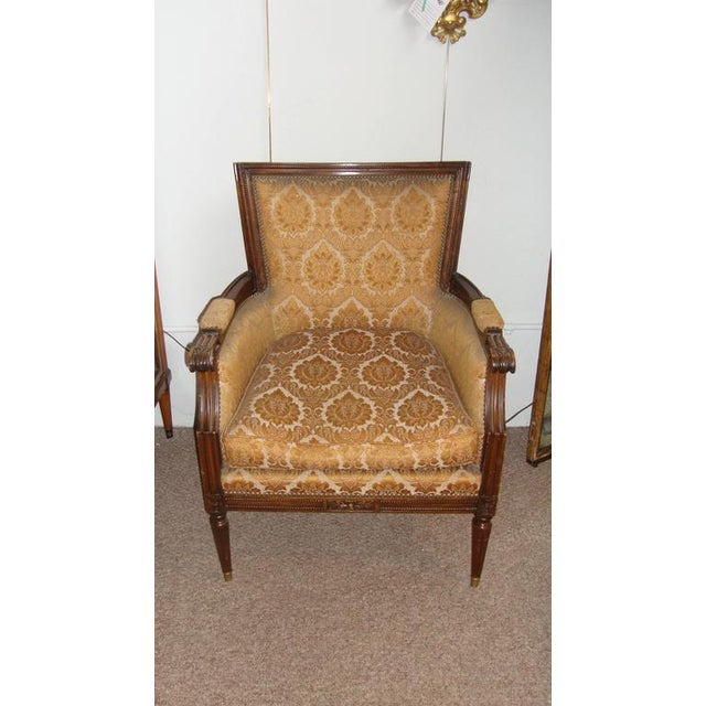 Pair of Louis XXI style armchairs by Maison Jansen with brass cap feet by Maison Jansen floral motif fabric.