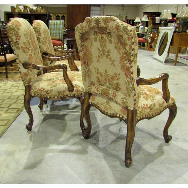An immaculate set of 4 Gerard arm chairs by Hooker Furniture with a French Country feel. Carved wood cabriole legs with...