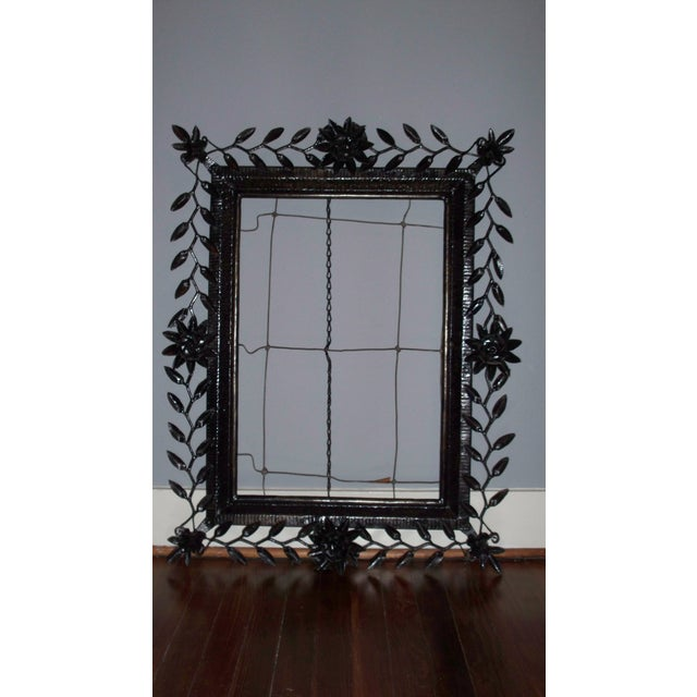 Beautiful vintage black wrought iron statement piece for your home. Would be the perfect frame for a nice piece of art or...