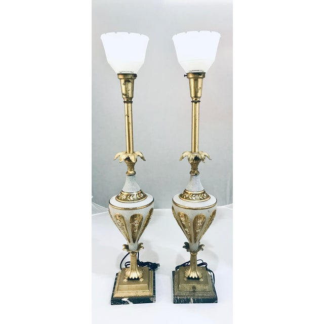 "This is a gorgeous and rare pair of mid-century glass and brass torchiere table lamps 37"" tall."
