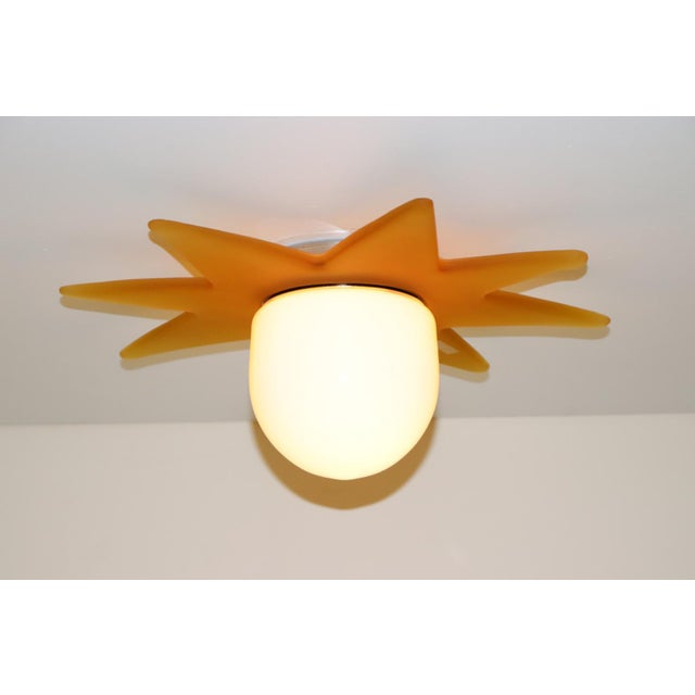 Italian Murano Ceiling light in Murano white glass diffuser and cast amber glass accent. Mounting: Chromed metal. Flash...