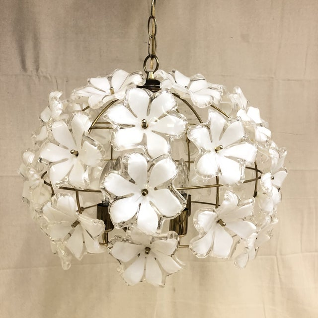 Vintage White and Gold Flower Chandelier This 4-light chandelier features an abundance of white plastic flowers with gold-...