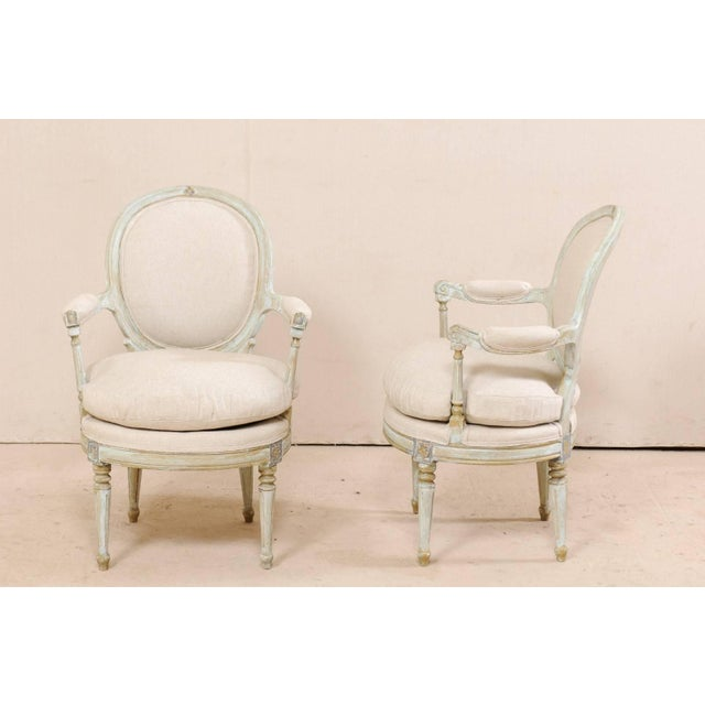 Mid 20th Century Pair of French Oval-Back Bergère Chairs With Delicately Carved Floral Motifs For Sale - Image 5 of 11